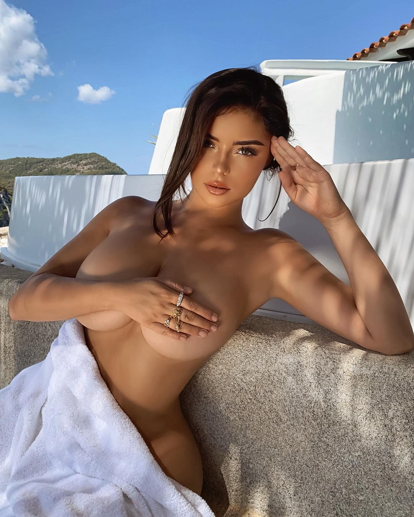 Demi Rose Unleashes Boobs As She Thrills In Frontless Negligee